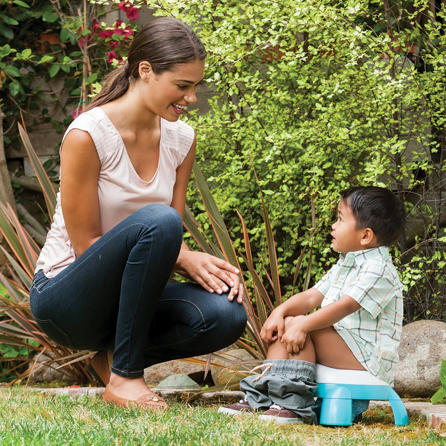 Mother and son with Infantino portable potty